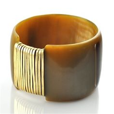 """Koro Bow Tie Cuff. This cuff features a panel of wrapped brass wire that contrasts beautifully with the horn. Made in Kenya from recycled Ankole cow horn and recycled brass wire. Width is 2""""."""