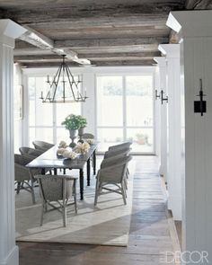 Beautiful dining room with rustic wood beam ceiling, wood floors, area rug, dark. - Home Decor Designs Trends Cottage Dining Rooms, Country Dining Rooms, Dining Room Table, Banquette Dining, Country Living, Dining Area, Beautiful Dining Rooms, Dining Room Inspiration, Design Inspiration