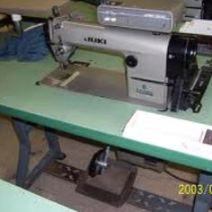 Old green industrial sewing machine like the one my grandmother would use to contract sew disposable coveralls.