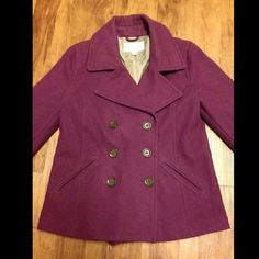 Plum Colored Pea Coat! Plum colored Old Navy pea-coat worn a couple of times . It has no rips or tears and all buttons are intact. It's lined with 100% Polyester. Thick and warm with pockets. Buttons are a medium brown color Jackets & Coats Pea Coats