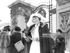 Acting Sister R.C. Child, of Haslar Hospital, Portsmouth, leaving Buckingham Palace after being decorated at a recent Investiture.'