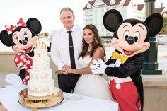 Danielle and Ryan had a true fairy tale wedding cake with some special help cutting it from Minnie and Mickey!