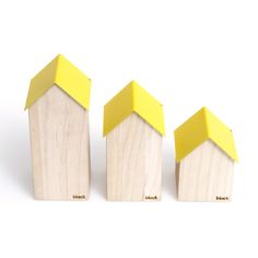 Yellow Wooden Storage Houses -Small: These little Storage House are a handy solution for keeping your everyday items safe. The tallest will hold pens on your desk, the medium is great for keys and the small will catch all your jewellery and cufflinks.