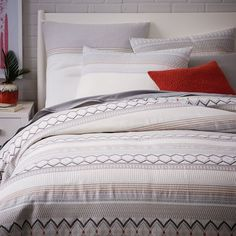 When this goes under $100, it's going to belong to me!  Organic Nordic Stripe Jacquard Duvet Cover + Shams | west elm