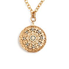 CHARLEY PENDANT - No need to pile on the necklaces.  This one does all the work for you.  Featuring a contemporary take on the Golden Age, this delicate round locket is dotted with seed pearls and sapphire Swarovski crystals.  Looks as fabulous with jeans as it does with a wrap dress and boots. - 14K gold finish; swarovski crystals; seed pearls - 22 long - Toggle clasp $188.00 www.michell.kitsylane.com
