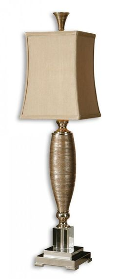 Uttermost - This lamp has metallic gold finish over textured porcelain with polished chrome metal and crystal accents. The square semi bell shade is a silkened golden champagne textile. Reg. Price 311.90 Our Price $248.60