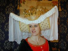 The 'Cross Tree' Headdress is an accurate reproduction of the Headdress worn on the Effigy of Princess Beatrice, Countess of Arundel in the Fitzalan Chapel Arundel Castle, West Sussex, England and inspired this range of Hats and Headdresses. They are only for the seriously Authentic Re-enactor or Medieval Interpretor.
