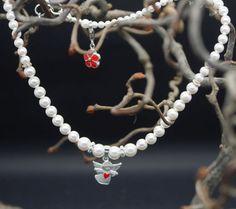 https://www.kinderschmuck-silberschmuck.de/Taufschmuck/baby-first-pearls/Taufschmuck-mit-Design-Schutzengel-Kinderkette::974.html