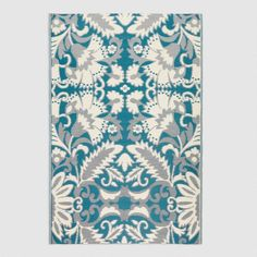 Featuring our exclusive blue and ivory floral design, our reversible woven floor mat is a chic, easy-to-clean and resilient addition to any indoor or outdoor
