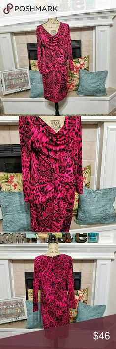 Thalia Sodi  animal print runched waist dress  LG With its figure-flattering design, this stylish women's dress can be accessorized to fit any occasion. This fun animal print creates a casual look perfect for any day of the week. Enhance your wardrobe with a chic pink for a stylish, feminine look. The below knee length is versatile enough to be worn to both semi-formal and casual events and occasions. This casual style with 3/4 sleeves is ideal for cross season wear. 95% poly 5% Spandex  L…