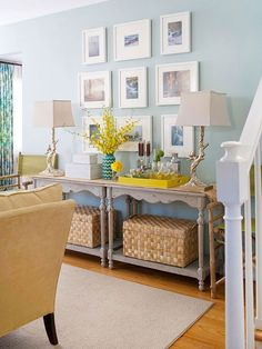 love the idea of combining 2 identical sofa tables for a long wall - great symmetry & the soft weathered gray against the eggshell blue is a great marriage