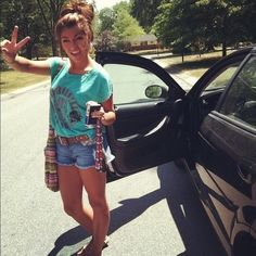 My summertime dream. Drivin' with my learner's permit, wearing some gorg clothes,  making a peace sign at a camera. Yup, that's where it's at.