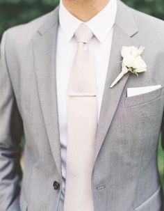 Grey or black tux. White tie for groomsmen, white bow tie for groom