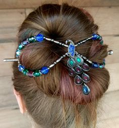 Stunning! Colors on Parade peacock flexi clip with bright jewel tones of sapphire blue, emerald green, and amethyst purple. Look how much hair a mega flexi will hold!