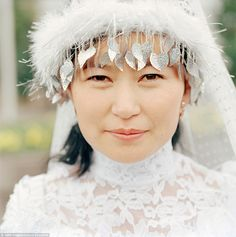 Ethereal: In Kazakhstan, typically brides will wear a headdress called a 'saukele' - they will also wear a facial veil