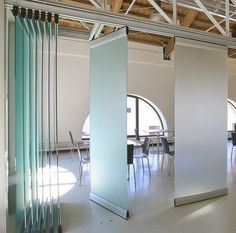 Modernglide movable acoustic wall Modernglide sliding folding partition Modernglide sliding glass partition Modernglide sound absorbant panels, walls that move: