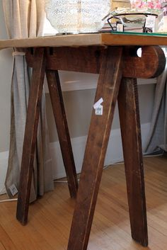make table using old wooden saw horses as legs