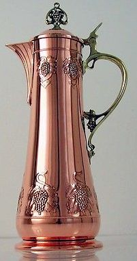 WMF Art Nouveau flagon, machine embossed copper with cast brass hardware, ostrich mark and 29, 36-1/2 cm H.