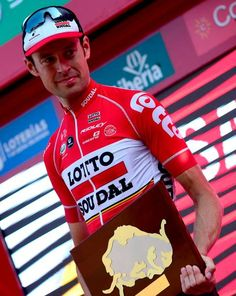 Lotto Soudal's Belgian cyclist Sander Armee celebrates on the podium after winning the 18th stage of the 72nd edition of 'La Vuelta' Tour of Spain...