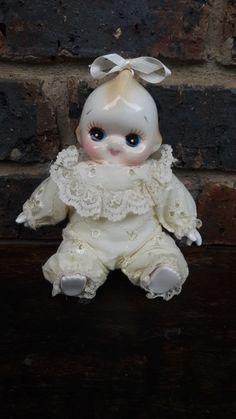 Porcelain Kewpie doll