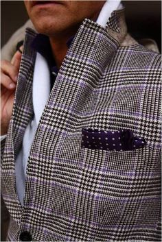 Plaid sports coat with polka-dot pocket square