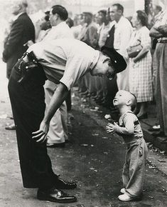 Faith and Confidence … William C Beall, of the Washington Daily News, won in 1958 for this photograph of a policeman and a two-year-old boy trying to cross a street during a parade. Photograph: William C Beall
