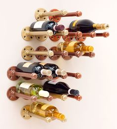 Showcase your wine bottles with this chic, do-it-yourself wine rack from design expert, Danny Seo. Not only is this inexpensive wine rack easy-to-install, but you can show off your creative side by personalizing and designing your own pattern too. Wine Rack Uses, Wine Racks, Pot Racks, Dyi Wine Rack, Diy Rack, Danny Seo, Deco Originale, Creation Deco, Industrial Pipe