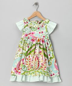 Cheerful ruffles that look like they're ready to dance trace the skirt of this essential dress. Whether a little one is toe tapping or leaping for joy, the airy material and tie will allow for the highest, silliest movements.100% cottonMachine wash; hang dryImported