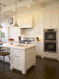 all white, marble counter tops, dark floors