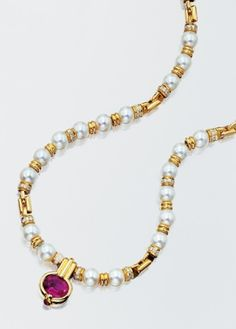 Gold, Cultured Pearl, Pink Tourmaline and Diamond Necklace   18 kt. gold, composed of a single strand of 34 cultured pearls, approximately 7.5 to 7.0 mm., spaced by gold rondels alternately set with 180 round diamonds, approximately 2.55 cts., suspending one oval pink tourmaline pendant, approximately 3.85 cts., within a gold frame of conforming shape, tipped by one small round cabochon ruby. Length 17 inches.