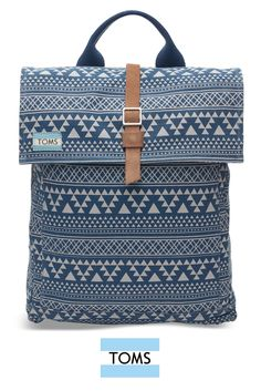 TOMS Navy Tribal Geo Canvas Trekker Backpack with a padded tech pocket, it can hold a 13-inch laptop and more.
