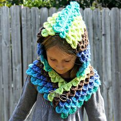 This adorable hood utilizes the crocodile stitch, but instead of scales you are crocheting feathers! I love the way the Caron Cakes color changes work with this pattern. You will need more than one cake though, the feathers use a bit of yarn.
