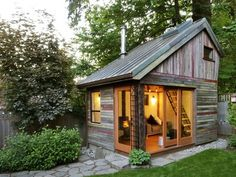 little house built from recycled barn boards art-studio-ideas