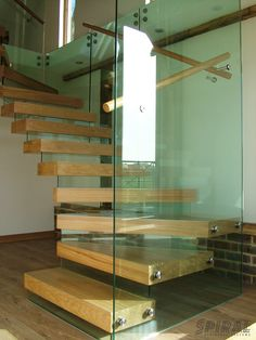 Oak and Glass Staircase made to measure for a recent barn conversion. By Spiral Staircase Systems. #Staircase #Glass