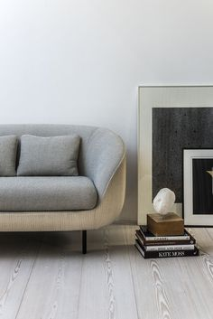 gorgeous living room with alternative side table. Fredericia sofa Haiku Low by GamFratesi. Haiku is an eye-catching and inviting design statement for hotel lobbies, executive offices and private homes. The modern contemporary design partners well with both high-tech and classical interiors.