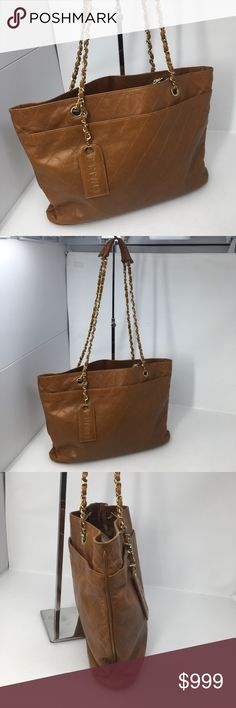 Authentic Chanel Quited CC Logo Charm Shopper Tote Authenticity guaranteed, please look closely at all photos, there is wear and patina on this bag a few spots in the photos.  Still a gorgeous bag with lots of use left.  Size is 16 x 10 x 4 inches handle drop is 12 inches. Will include a new dustbag with the sale.  All purchases over $500 are authenticated at Posh hq. CHANEL Bags Totes