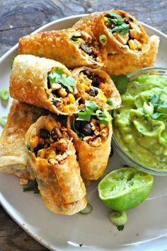 Vegan tex mex egg rolls are one of the fastest and definitely one of the most delicious appetizers of all time. Perfect for parties or just everyday! dinner Vegan Tex Mex Egg Rolls - Rabbit and Wolves Vegan Foods, Vegan Dishes, Vegan Vegetarian, Vegan Finger Foods, Vegan Lunches, Vegan Apps, Raw Vegan, Good Vegetarian Recipes, Vegetarian Comfort Food