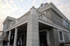 China just 3D-printed an entire mansion | A Chinese construction company unveiled its two largest 3D-printed buildings to date. One is a grand-looking, three-story mansion (well, McMansion), and the other is a more utilitarian five-story apartment block. Both are made entirely by 3D printers creating layers of materials that form walls and roofs. [3D Printing News: http://futuristicnews.com/tag/3d-printing/ 3D Printers for Sale: http://futuristicshop.com/category/3d-printers/]