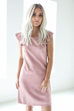 """• Dusty pink low back ruffled dress • Available in S, M, L. Model is 5' 4"""" and wearing a size small • 75% Cotton, 25% Polyester"""