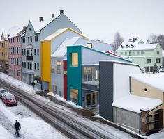 a cohesive blending of typologies fills leftover urban gaps to create the colorful child care center in the aging city of selb.