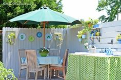 outdoor dining area in the garden - such fun colors and ideas (love the Grow wall)!