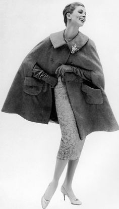"""Suzy Parker in Mainbocher's corduroy cape lined in satin worn with lace-over-lamè dress, the """"Four Leaves"""" sapphire and diamond clip is by Jean Schlumberger, photo by Avedon, Harper's Bazaar, Dec. 1956"""