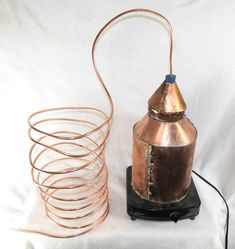 Homebrewing spirits Remaking History: Build Your Own Copper Still Moonshine Still Plans, Copper Moonshine Still, How To Make Moonshine, Making Moonshine, Home Distilling, Distilling Alcohol, Essential Oil Still, Essential Oils, Homemade Moonshine