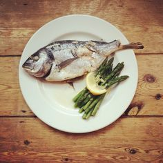 Simple dinner - baked sea bream and steamed asparagus with a lemon and ghee dressing #fish #paleo #detox #lowcarb #grainfree #organic #healthy #protein #whatsonmyplate #nutrition #simple #fastandfresh by anoushkadavy