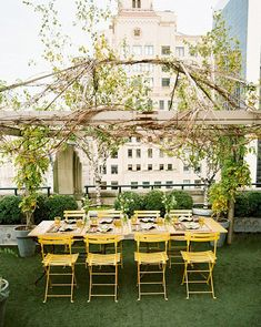 "My ""shabby chic"" decks have gotten a bit too shabby. They need reviving. Something like this would be nice  yelllow bistro chairs, astro turf deck"