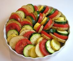* Baked Veggie Spiral: 2 tbsp olive oil (divided), 1 large sweet yellow onion cut in half and sliced, 2 cloves of garlic, minced, 1-2 russet potatoes, peeled, 1 zucchini, 1 yellow squash, 3 large Roma tomatoes, Sea salt, freshly cracked black pepper, to taste, Dried thyme, to taste, 1/2 cup of grated Parmesan cheese