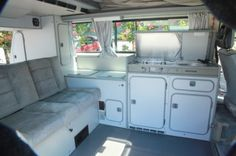 What the inside is like, double stove, fridge, tables, 2 double beds (1up,1 down)well thought out storage.