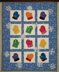 Adorable Winter Mittens Wall Hanging tutorial by Debra Dooley from Damsel Quilts & Crafts. This cute wall quilt pattern uses free applique patterns for mittens and snowflakes that will make any quilt look festive.