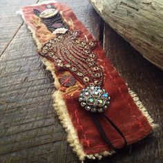Everything on this vintage fabric cuff (apart from the thread used to hand stitch it) is recyled and repurposed from an Indonesian puppet's dress, vintage rhinestone buttons, antique sari to velvet curtain by quisnam on Etsy