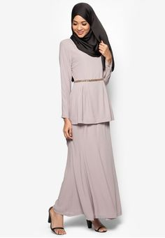 Baju Kurung Moden Baqrisyah from Butik Sireh Pinang in Grey Put on this Baju Kurung Moden Baqrisyah by Butik Sireh Pinang for an elegant, chic look. The traditional baju kurung gets an upgrade in this piece which features a beaded waistline and front pleat details. Instead of the usual side pleats found o... #bajukurung #bajukurungmoden